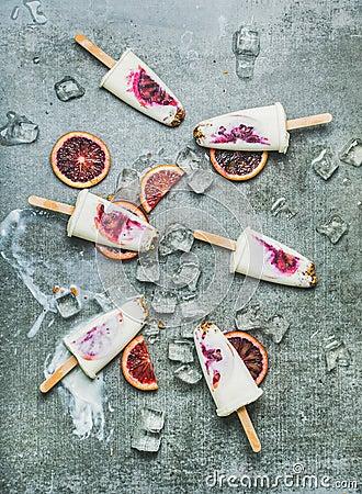 Free Blood Orange, Yogurt And Granola Popsicles On Ice, Concrete Background Stock Images - 107847044