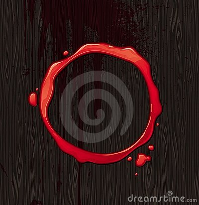 Bloody round frame on black wood background