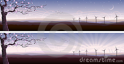 Blooming tree and several wind turbines