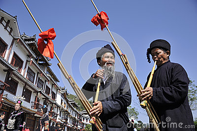 Blow Lusheng,Miao nationality men Editorial Stock Image