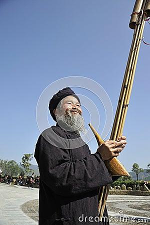 Blow Lusheng,Miao nationality men Editorial Photo