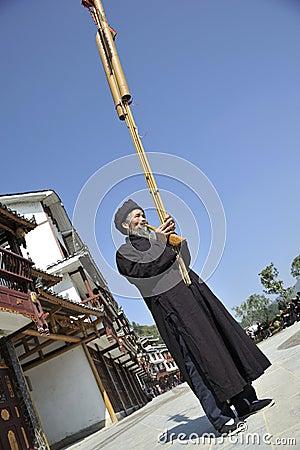 Blow Lusheng, Miao nationalitymän Redaktionell Fotografering för Bildbyråer