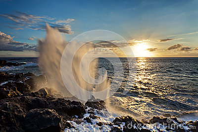 Blowhole on rocky coastline