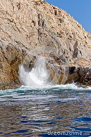 Blowhole on rugged coastline