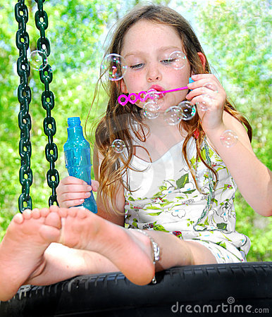 Free Blowing Bubbles On Tire Swing Royalty Free Stock Photography - 5205337