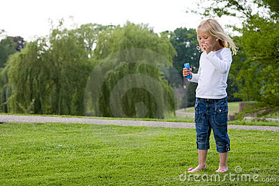 Blowing bubbles in the park