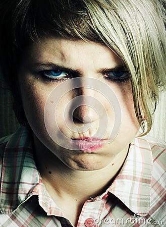 Blowing cheeks.
