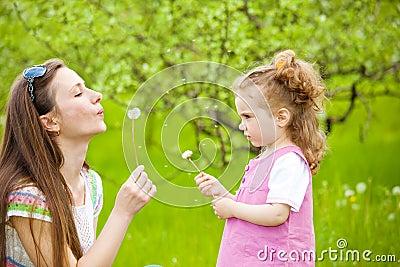 Blowing dandelion away