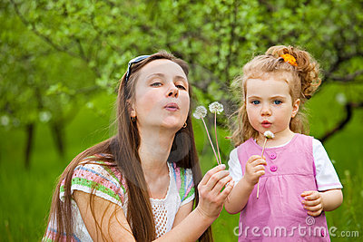 Blowing dandelion away