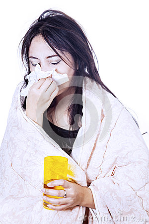 Blowing nose with tissue isolated over white