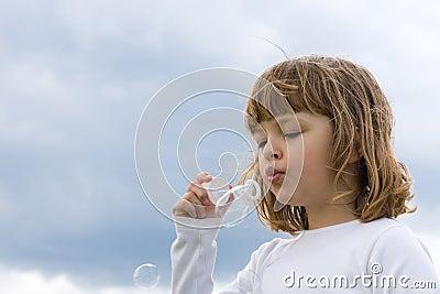 Blowing soap baubles