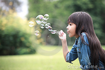 Blowing a soap bubbles