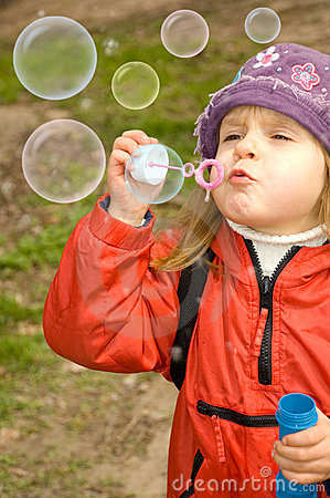 Blowing soap bubbles out