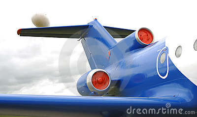 Blue airplane engine, tail and windows