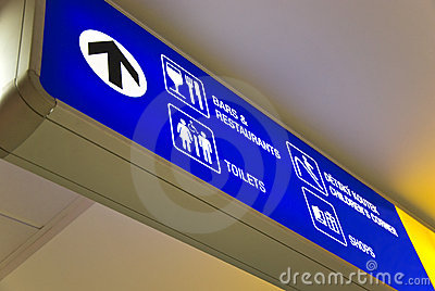Blue airport direction sign