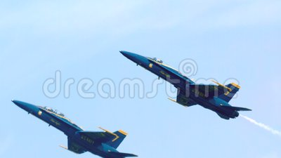 Blue angels streaking through sky slow motion stock video