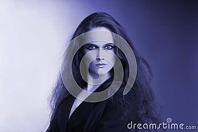 Blue artistic portrait of attractive woman