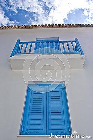 Blue balcony in streets of Skiathos island in Gree