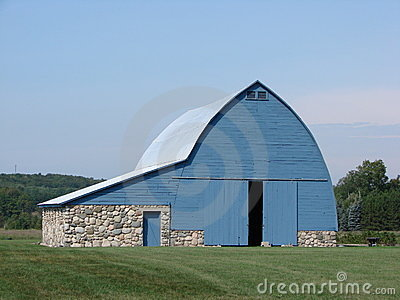 Blue barn with stone foundation