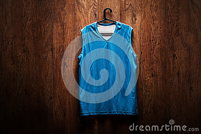 blue basketball jersey hanging on a wooden wall stock photo image 45042422. Black Bedroom Furniture Sets. Home Design Ideas
