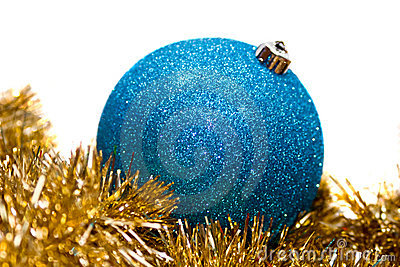 Blue bauble on gold tinsel