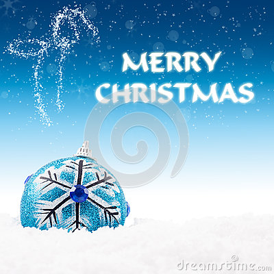 Blue bauble on snow with christmas greeting