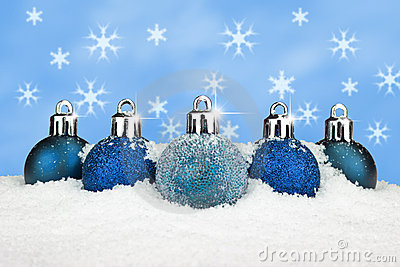 Blue baubles in the snow
