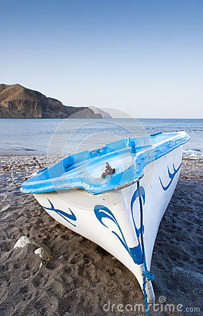 Blue boat boat on a beach
