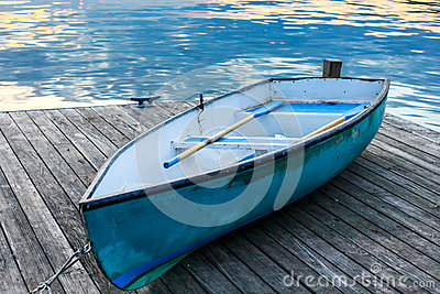 Blue boat with water reflection