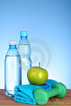 Blue bottle of water and sport stuff