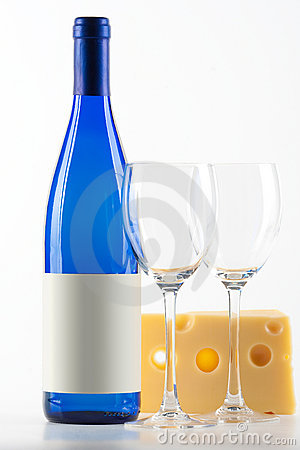 Blue bottle of white wine, two wine glasses and ch