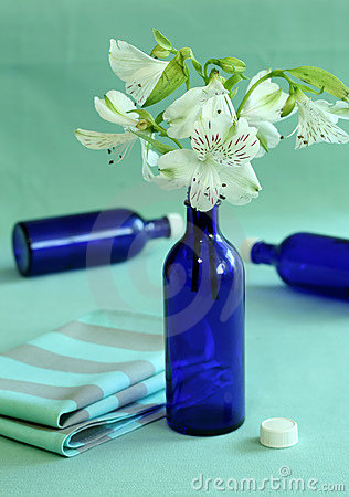 Blue bottles and flowers.