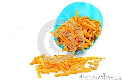 Blue bowl with paprika potato chips sticks