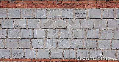 Blue breeze block and  brick wall