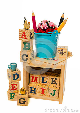 Blue bucket with color pencil on wooden alphabet block box