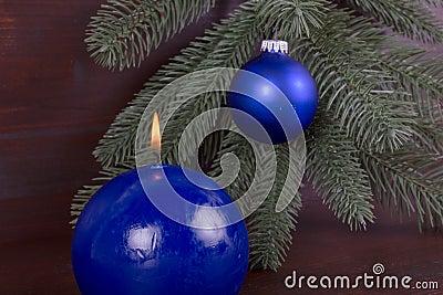 Blue burning candle on Christmas