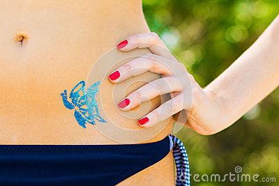 Blue butterfly glitter-tattoo