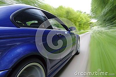 Blue Car Speeding