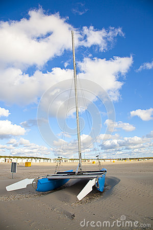 Blue catamaran boat on beach