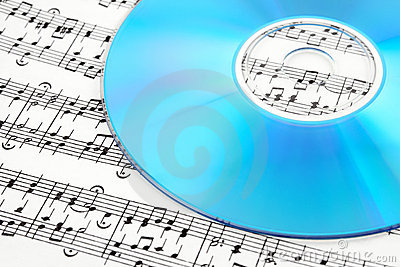 Blue CD or DVD on sheet music