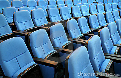 Blue chair seats in empty conference room