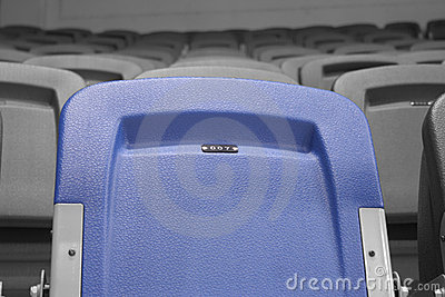 Blue chair on stadium reserved for 007