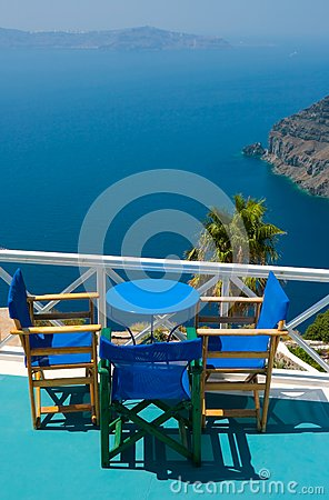 Blue chairs and table in Santorini