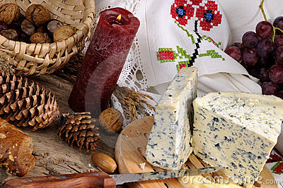 Blue cheese, fruits and objects isolated