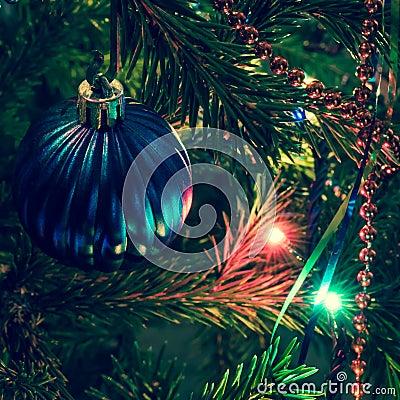 Blue christmas ball on xmas tree