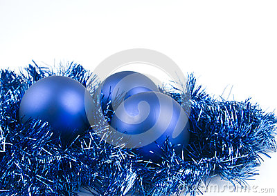 Blue christmas balls on white