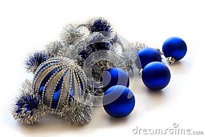 Blue Christmas balls on white background.