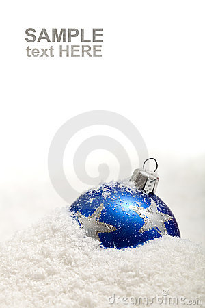 Blue christmas decoration in snow with copy space