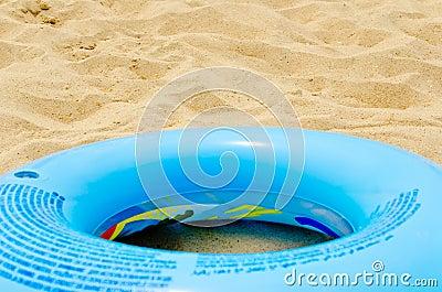 Blue circle on sand