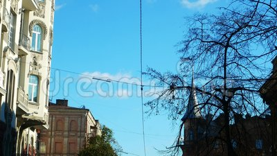 Blue city sky from a car. Kiev, Ukraine. The view from the car on the go stock video footage